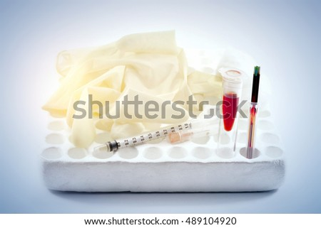 Blood sample in tube blood for screening test and syringe on white background.(blue tone and soft tone concept))