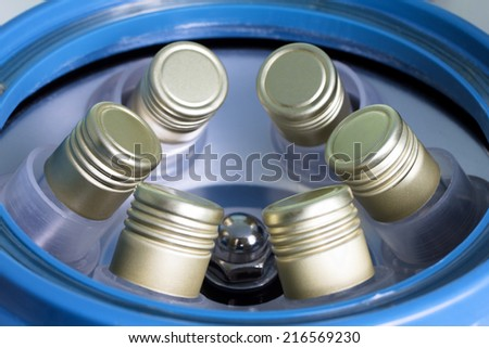Blood tubes placed in the centrifuge for separation of plasma - stock photo