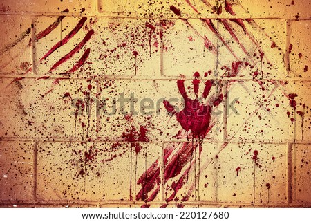 Bloodstain of suffering on wall - stock photo