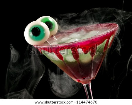 Bloody cold halloween cocktail with eyes - stock photo