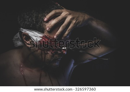 bloody fork eyes fixed on man - stock photo