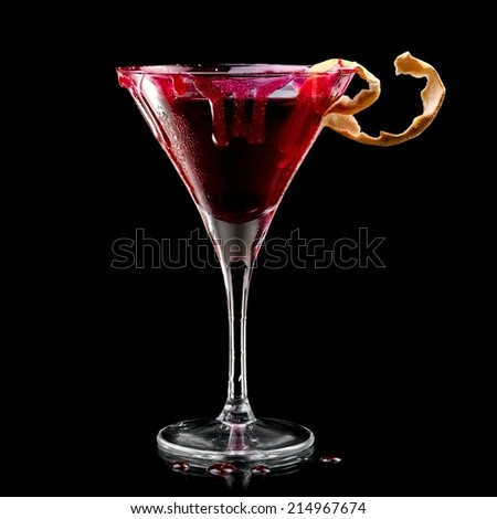 Bloody Halloween cocktail in martini glass - stock photo