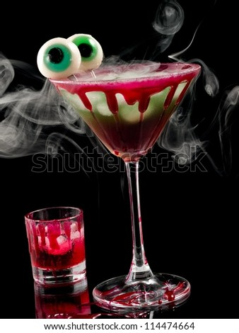 Bloody halloween cocktail with two eyes - stock photo