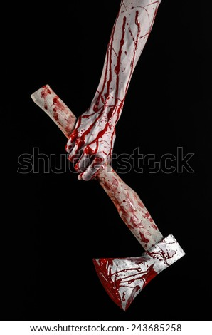 Bloody Halloween theme: bloody hand holding a bloody butcher's ax isolated on black background in studio - stock photo
