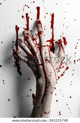 Bloody halloween theme: bloody hand print on a white leaves bloody wall - stock photo