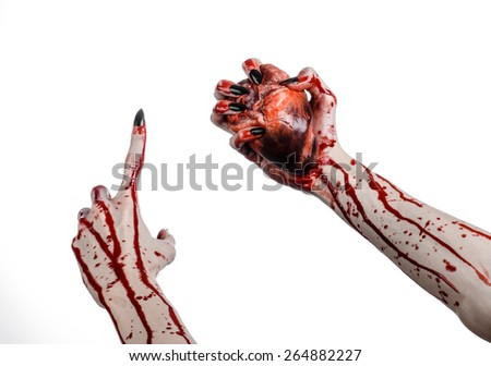 Bloody horror and Halloween theme: Terrible bloody hands with black nails holding a bloody human heart on a white background isolated background in studio