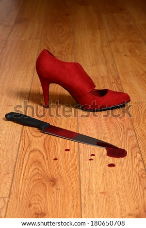 bloody knife with high heel shoe - stock photo