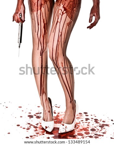 Bloody Legs with Large Syringe and white heels - stock photo