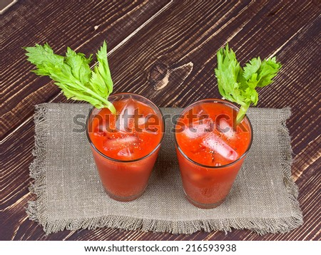 Bloody mary cocktails  on wooden background - stock photo