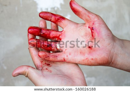 Bloody red hand on the background and reach. Use it for the concept of fear of violence or terror.