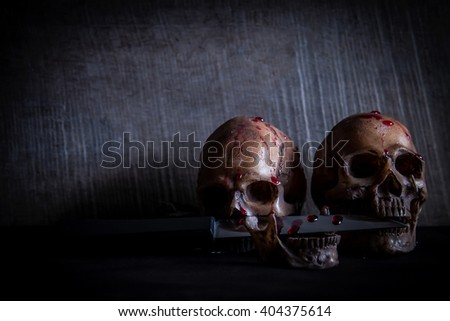 Bloody skull in dark tone with vignette style. still life photo with dark tone.  - stock photo