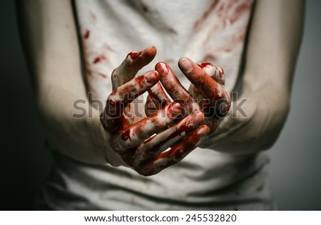 Bloody theme lone murderer: the murderer shows bloody hands and experiencing depression and pain - stock photo