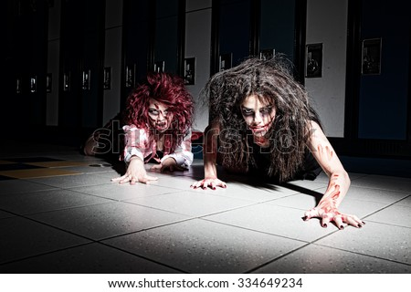 Bloody zombie school kids crawling towards the viewer. - stock photo