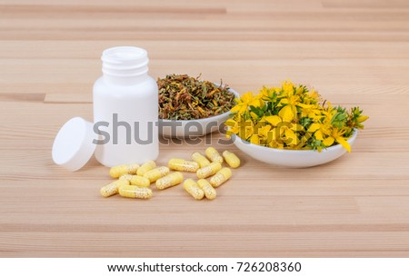 blooming St. John's wort and medicines / St. John's wort / herbal medicine