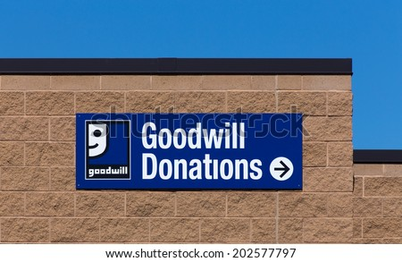 BLOOMINGTON, MN/USA - JUNE 21, 2014:  Goodwill store exterior sign. Goodwill Industries is a nonprofit organization that provides job training programs for people with disabilities.