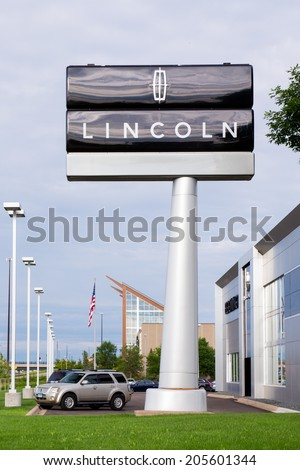 BLOOMINGTON, MN/USA - JUNE 22, 2014: Lincoln automobile dealership exterior. Lincoln is a division of the Ford Motor Company that sells luxury vehicles under the Lincoln brand. - stock photo