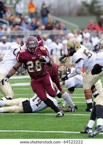 BLOOMSBURG, PA - NOVEMBER 6: Bloomsburg running back Franklyn Quiteh (#28) explodes through a hold in a PSAC conference game against Kutztown November 6, 2010 in Bloomsburg, PA.