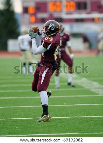 BLOOMSBURG, PA - NOVEMBER 6: Bloomsburg University wide receiver Kyle Jackson catches a pass prior to a football game November 6, 2010 in Bloomsburg, PA - stock photo