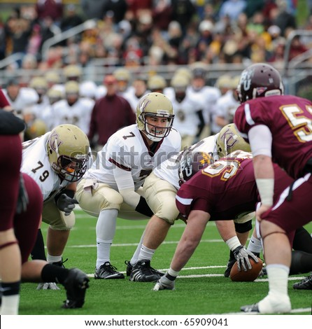 BLOOMSBURG, PA - NOVEMBER 6: Kutztown quarterback Kevin Morton (#7) shown under center calling a play at the line of scrimmage during a PSAC conference game November 6, 2010 in Bloomsburg, PA - stock photo