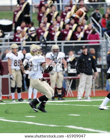 BLOOMSBURG, PA - NOVEMBER 6: Kutztown running back Josh Mastromatto prepares to catch a kickoff in a  PSAC conference game November 6, 2010 in Bloomsburg, PA - stock photo