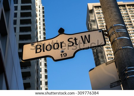 Bloor Street West Street Sign Toronto. A street sign indicating Bloor Street West in downtown Toronto, Canada. - stock photo