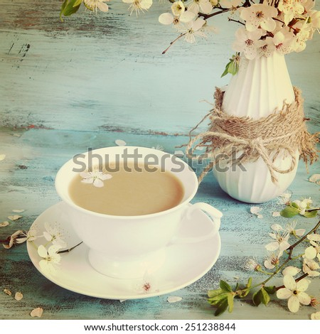 blossom apple tree in vase on wooden blue background. Vintage style - stock photo