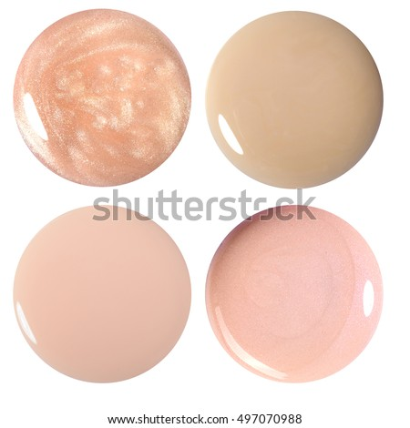 Blots of nail polish and foundation. Isolated on white. Photo