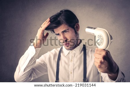 blow-dry your hair - stock photo