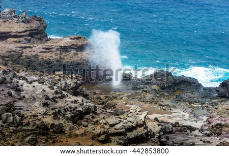 Blow hole with water spraying out, Maui Isalnd Hawaii - stock photo