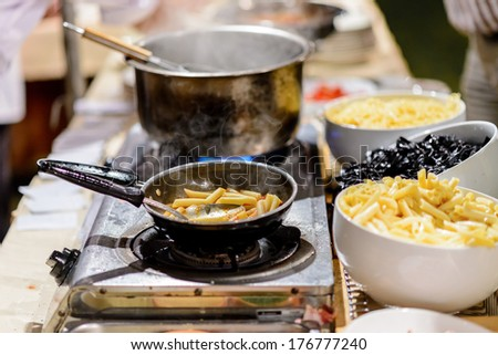 blow with different noodle dishes, both of which include meat and colorful garnishes - stock photo