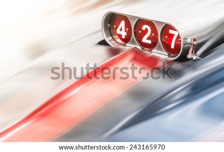Blower on Classic Car for 427 Cubic Engine Blurred as if Moving Fast - stock photo