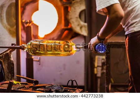 Blowing Glass Closeup of Propane Gas Flame on Finished Piece - stock photo