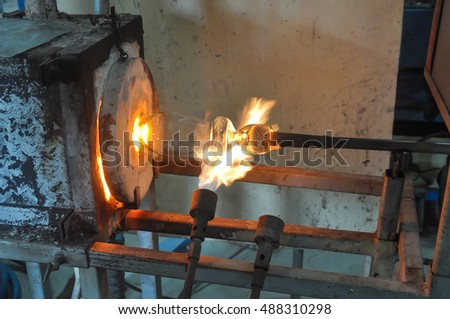 Blowing Glass,Glass furnace,Image of a factory producing glass cup,glass blowing in factory