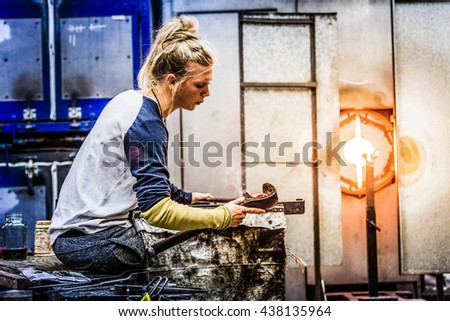 Blowing Glass Professional Caucasian Woman Working on a Vase. - stock photo