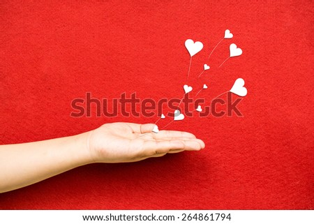 Blowing Hearts from a Hand - stock photo