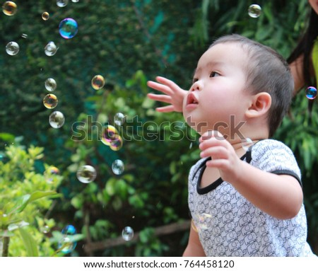 blowing the soap bubbles
