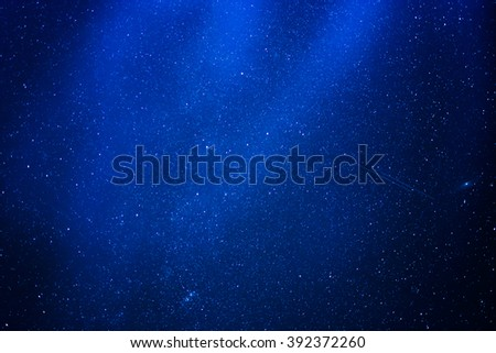 blue abstract background with stars in the sky - stock photo