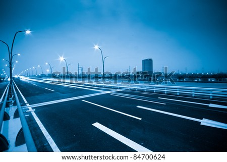 Blue Abstract blurred speed motion in urban highway tunnel - stock photo