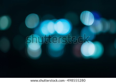 blue abstract bokeh on a dark background