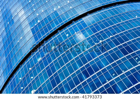 Blue abstract crop of modern office skyscraper - stock photo