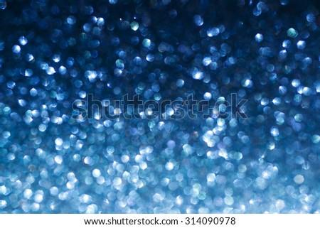Blue abstract glitter bokeh shiny blur background. Blue bokeh background - stock photo