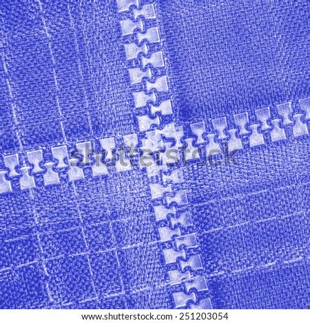 blue abstract textile texture, zippers in form of cross