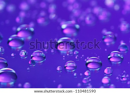 Blue abstract translucent water drops background, macro view - stock photo