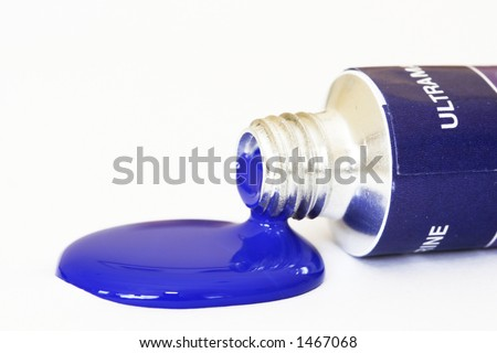 Blue acrylic paint pouring from a tube. Colour can be easily changed to any colour using hue/saturation in photo package