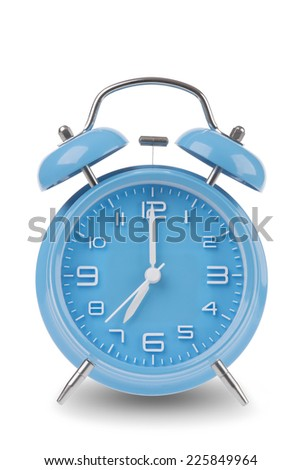 Blue alarm clock with the hands at 7 am or pm isolated on a white background, One of a set of 12 images showing the top of the hour starting with 1 am / pm and going through all 12 hours - stock photo