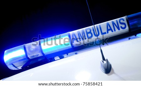 blue ambulance emergency light, isolated on black - stock photo
