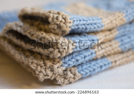 blue and beige knitted shower gift for baby boy