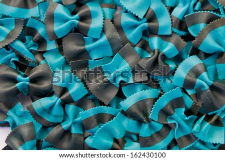 blue and black colored Farfalle Pasta on White