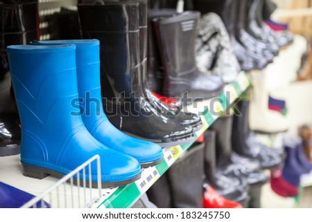 Blue and black waterboots are on the shop shelves