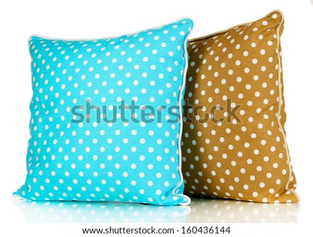 Blue and brown bright pillows isolated on white - stock photo